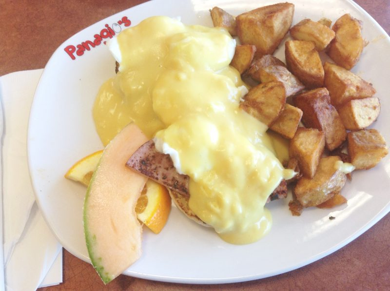 "Panagio's - ""Eggs Benny"" - Ham, Eggs with Hollandaise Sauce on an English Muffin, Homefries, and Fruits - HELLOTERI"